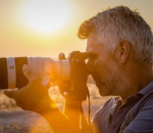 Better Moments Expert Laurent Baheux shooting at sunset