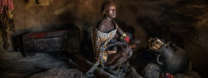 Christian Nørgaard ETHIOPIAEthiopia women with a baby OMO VALLEY TRIBES