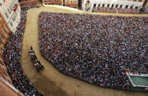 Aerial shot of jockeys and crowd of Palio di Siena