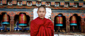 A Bhutanese monk dressed in red