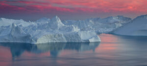 Pink sunset over Greenland's icebergs