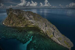 Aerial shot of Elephant Island and its crystal clear water in the Philippines.