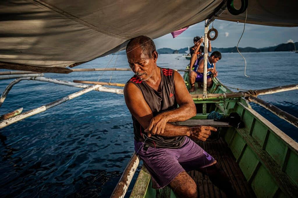 Local fishermen trying to catch fish near Palawan island, Philippines.