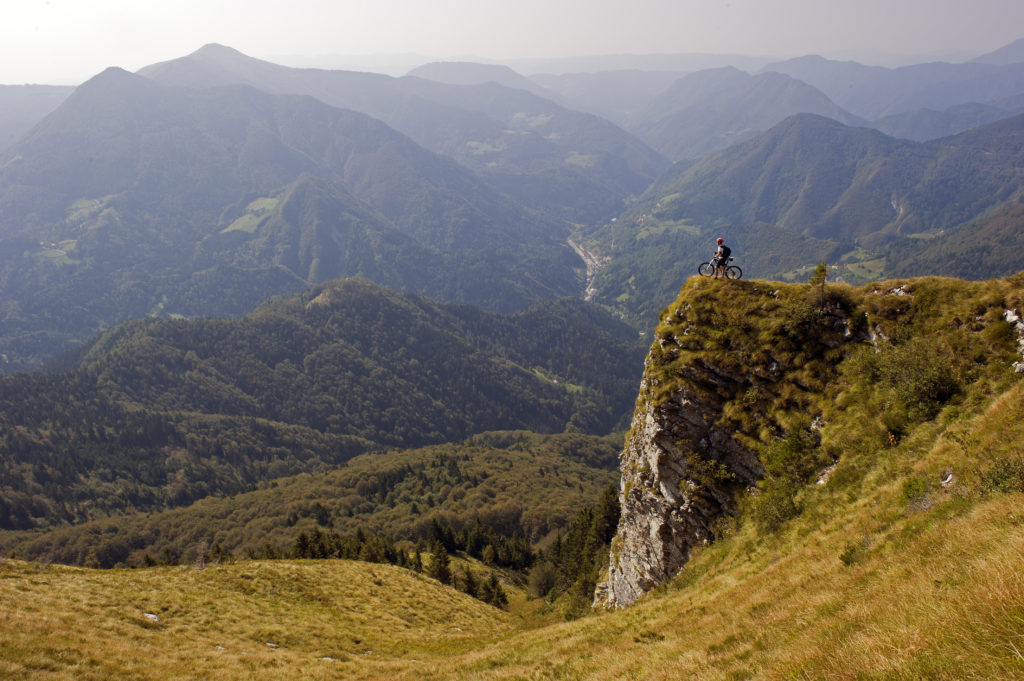 A bicyclist overlooks Soca Valley, Slovenia