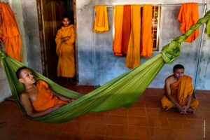 Better Moments Indochina - monk lazing in hammock