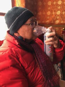 Passioante photographer Joe Lam with an oxygen mask in Nepal