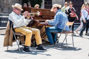 Street musicians in Barcelona playing trumpet and piano