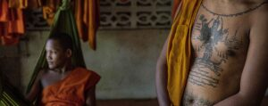 Laos - two monks - one with a tattoo