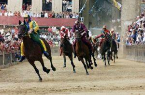 Horses racing at Il Palio di Siena - Marco Di Lauro