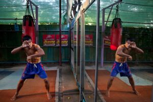 Thai boxer's reflection in a mirror