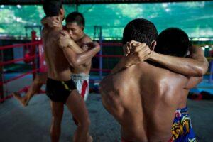 Four Thai boxer practising