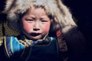 Mongolian boy with fur hat