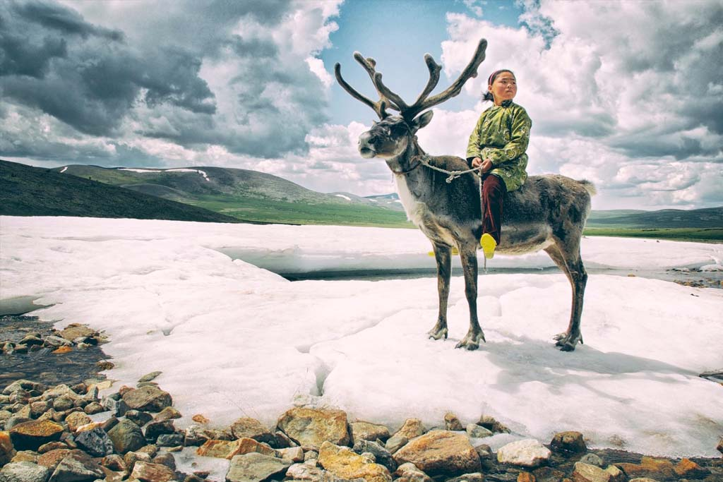 Mongolian girl on reindeer
