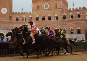 Horses racing at Il Palio di Siena, Italy