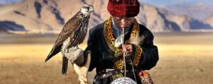 Young Mongolian boy with a tame Falcon