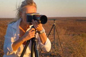 Female workshop guest with her camera in the Namibian desert