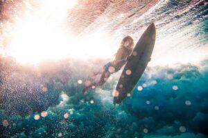 Underwater shot of a female surfer, photo by Kirill Umrikhin