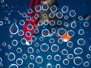 Water droplets mirroring athlete, photo by Kirill Umrikhin